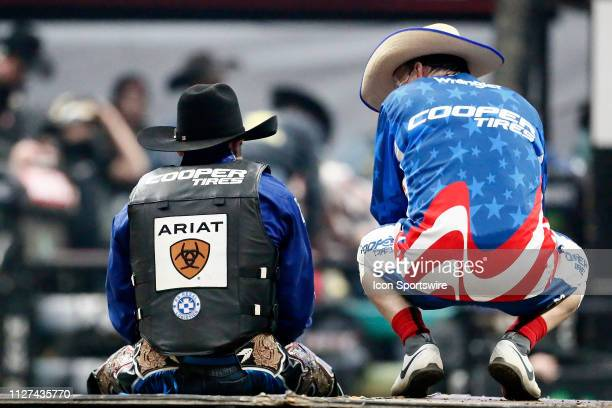Joao Ricardo Vieira rests next to Flint Rasmussen during the Professional Bull Riders Iron Cowboy presented by Ariat on February 23 at the Staples...