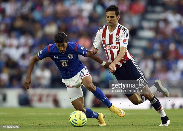 Joao Rojas of Cruz Azul vies for the ball with Raulo Lopez of Chivas during their Mexican Clausura tournament in Mexico City on February 21 2015 AFP...