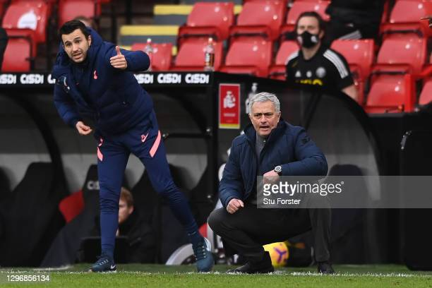 Joao Sacramento, Assistant Manager of Tottenham Hotspur and Jose Mourinho, Manager of Tottenham Hotspur give their team instructions during the...