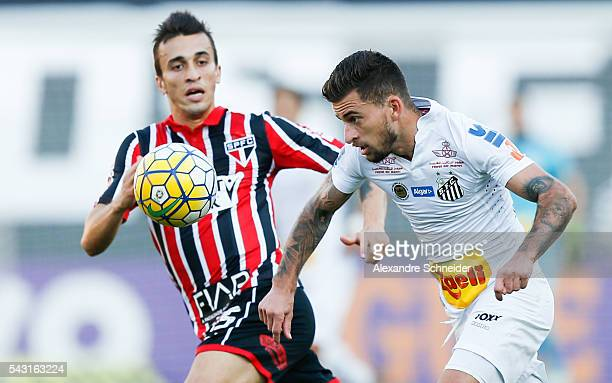 Joao Schmidt of Sao Paulo and Lucas Lima of Santos in action during the match between Santos and Sao Paulo for the Brazilian Series A 2016 at...