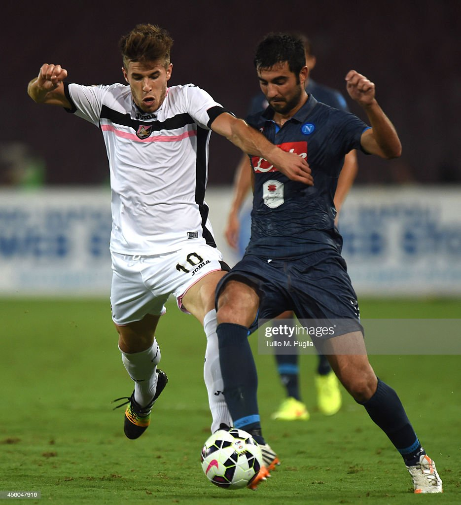 Joao Silva (L) of Palermo and Raul Albiol of Napoli compete for the ball during the Serie A match between SSC Napoli and US Citta di Palermo at Stadio San Paolo on September 24, 2014 in Naples, Italy.