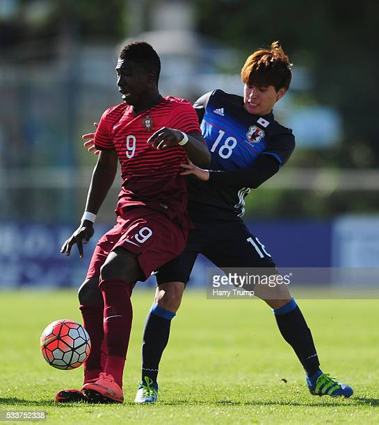 Joao Silva of Portugal is tackled by Takumi Minamino of Japan during the Toulon Tournament match between Japan and Portugal at Stade De Lattre on May...