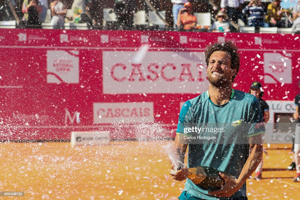 Joao Sousa from Portugal celebrates wining the match against Frances Tiafoe from United States of America for Millennium Estoril Open 2018 - Singles Final at Clube de Tenis do Estoril on May 06, 2018 in Estoril, Portugal.