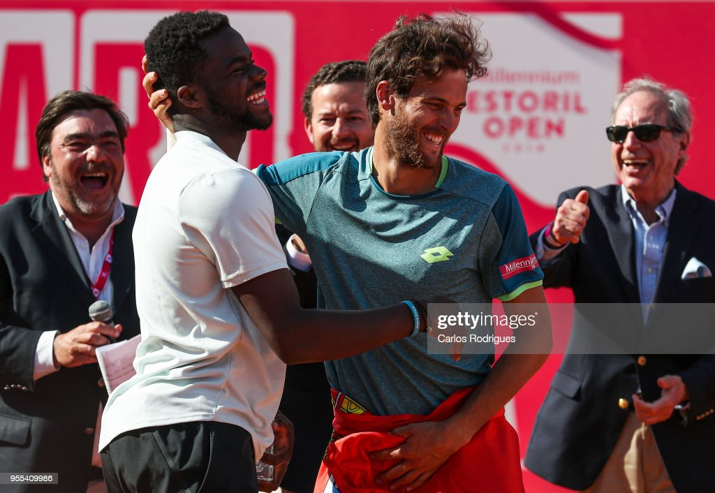 Joao Sousa from Portugal (R) with Frances Tiafoe from United States of America (L) after the match between Joao Sousa from Portugal and Frances Tiafoe from United States of America for Millennium Estoril Open 2018 - Singles Final at Clube de Tenis do Estoril on May 06, 2018 in Estoril, Portugal.