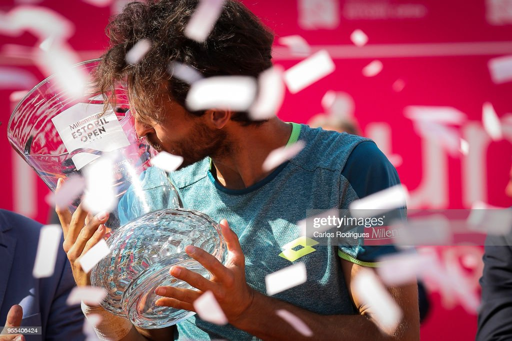 Joao Sousa from Portugal with the trophy after wining the match between Joao Sousa from Portugal and Frances Tiafoe from United States of America for Millennium Estoril Open 2018 - Singles Final at Clube de Tenis do Estoril on May 06, 2018 in Estoril, Portugal.