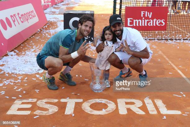 Joao Sousa of Portugal and his Coach Frederico Marques pose with the trophy after winning the Millennium Estoril Open ATP 250 tennis tournament final...