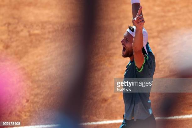 Joao Sousa of Portugal celebrates his victory over Stefanos Tsitsipas of Greece during the Millennium Estoril Open ATP 250 tennis tournament...