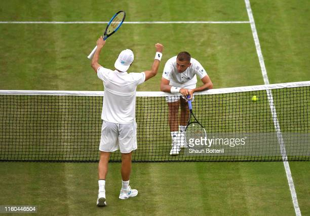 Joao Sousa of Portugal celebrates match point as Daniel Evans of Great Britain reacts in his Men's Singles third round match against Joao Sousa of...