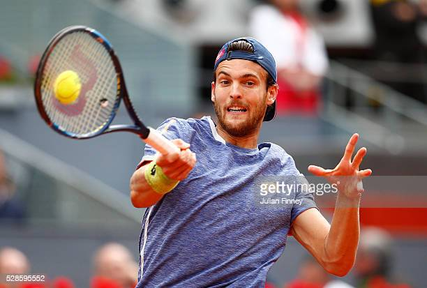Joao Sousa of Portugal hits a backhand during the Men's Singles Quarter Final match against Rafael Nadal of Spain during day seven of the Mutua...