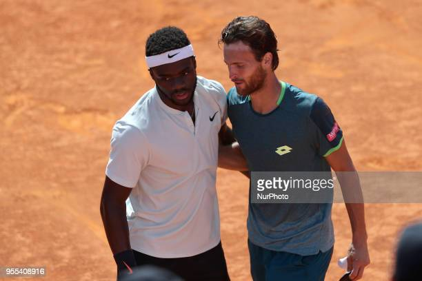 Joao Sousa of Portugal hugs Frances Tiafoe of US after winning the Millennium Estoril Open ATP 250 tennis tournament final at the Clube de Tenis do...