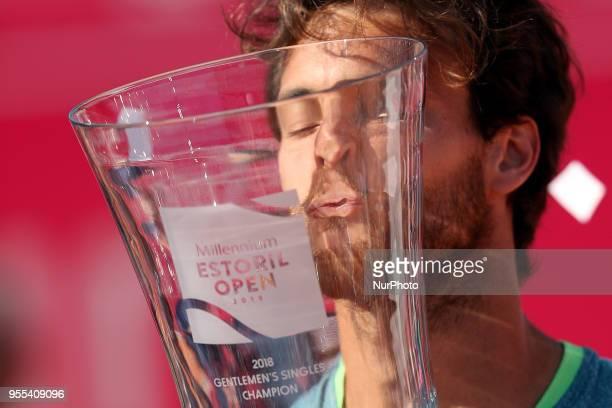 Joao Sousa of Portugal kisses the trophy after winning the Millennium Estoril Open ATP 250 tennis tournament final against Frances Tiafoe of US at...