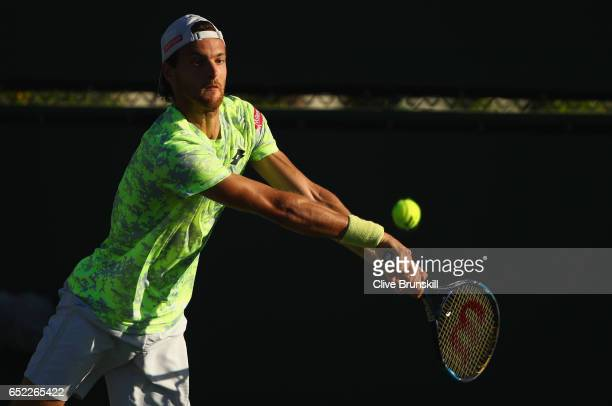 Joao Sousa of Portugal plays a backhand against Mischa Zverev of Germany in their second round match during day six of the BNP Paribas Open at Indian...