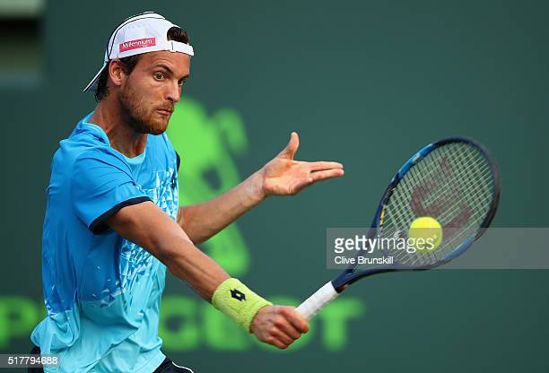Joao Sousa of Portugal plays a backhand against Novak Djokovic of Serbia in their third round match during the Miami Open Presented by Itau at...