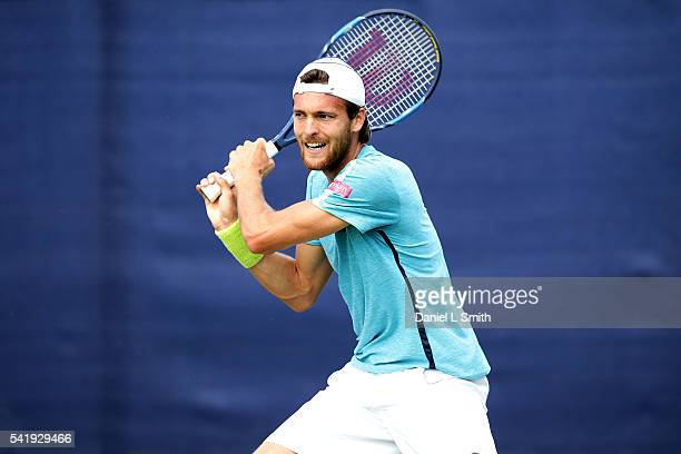 Joao Sousa of Portugal plays a backhand during his men's singles match against Dude Sela of Israel during day two of the ATP Aegon Open Nottingham at...