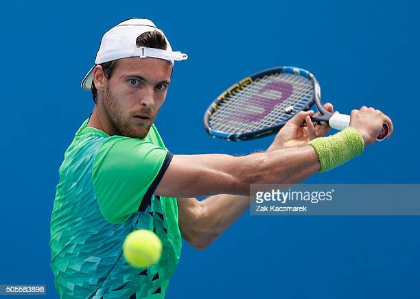 Joao Sousa of Portugal plays a backhand in first round match against Mikhali Kukushkin of the Ukraine during day two of the 2016 Australian Open at...