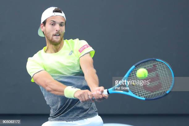 Joao Sousa of Portugal plays a backhand in his first round match against Dustin Brown of Germany on day one of the 2018 Australian Open at Melbourne...