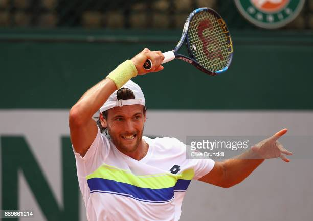 Joao Sousa of Portugal plays a forehand during the mens singles first round match against Janko Tipsarevic of Serbia on day two of the 2017 French...