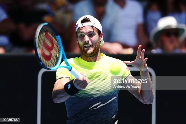 Joao Sousa of Portugal plays a forehand in his first round match against Donald Young of USA during day one of the ASB Men's Classic at ASB Tennis...