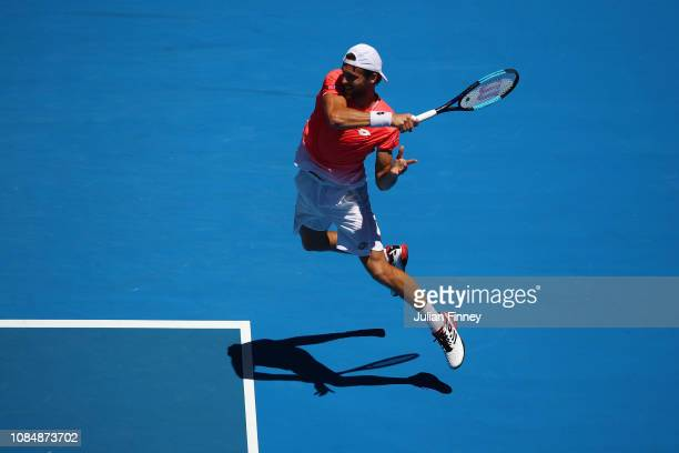 Joao Sousa of Portugal plays a forehand in his third round match against Kei Nishikori of Japan during day six of the 2019 Australian Open at...