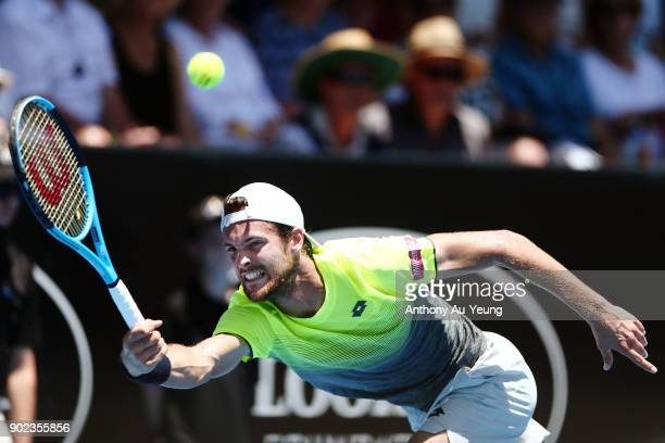 Joao Sousa of Portugal plays a shot in his first round match against Donald Young of USA during day one of the ASB Men's Classic at ASB Tennis Centre...