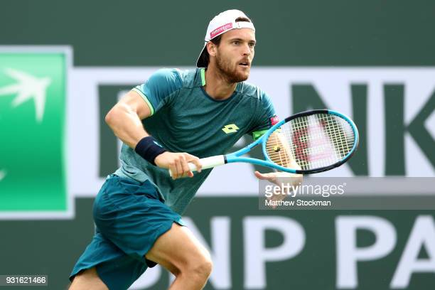 Joao Sousa of Portugal plays Milos Roanic of Canada during the BNP Paribas Open at the Indian Wells Tennis Garden on March 13 2018 in Indian Wells...