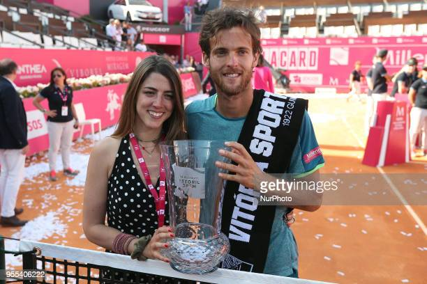 Joao Sousa of Portugal poses with his girlfriend after winning the Millennium Estoril Open ATP 250 tennis tournament final against Frances Tiafoe of...