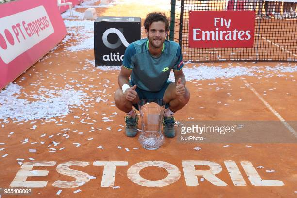 Joao Sousa of Portugal poses with the trophy after winning the Millennium Estoril Open ATP 250 tennis tournament final against Frances Tiafoe of US...