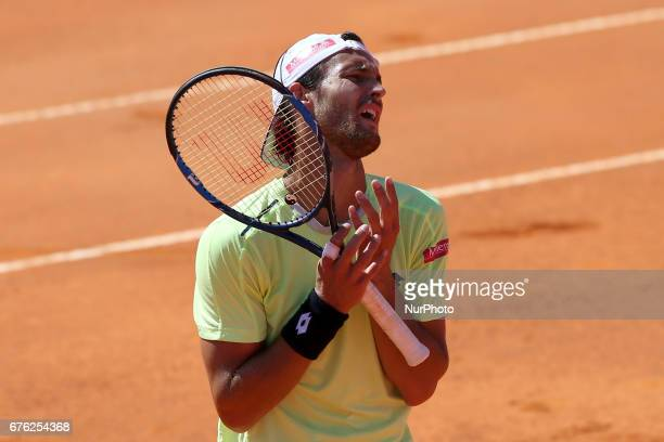 Joao Sousa of Portugal reacts during his game against Bjorn Fratangelo of US during the Millennium Estoril Open 1st round tennis tournament in...