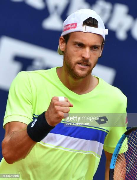 Joao Sousa of Portugal retacts during his final match against Germany's Philipp Kohlschreiber at the ATP tennis tournament Generali Open on August 5...