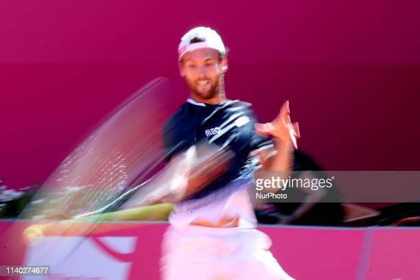 Joao Sousa of Portugal returns a ball to Alexei Popyrin of Australia during the Millennium Estoril Open Day 2 ATP 250 tennis tournament at the Clube...