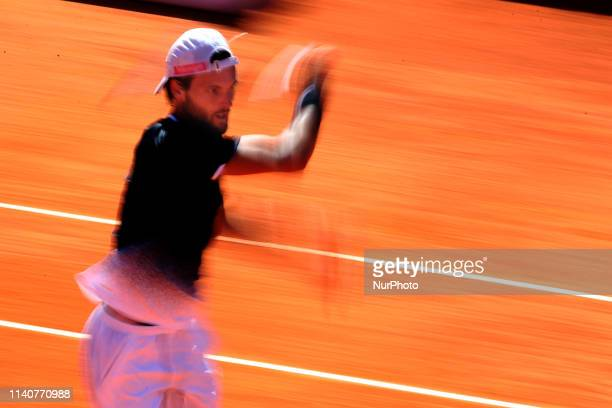 Joao Sousa of Portugal returns a ball to David Goffin of Belgium during the Millennium Estoril Open Day 4 ATP 250 tennis tournament at the Clube de...