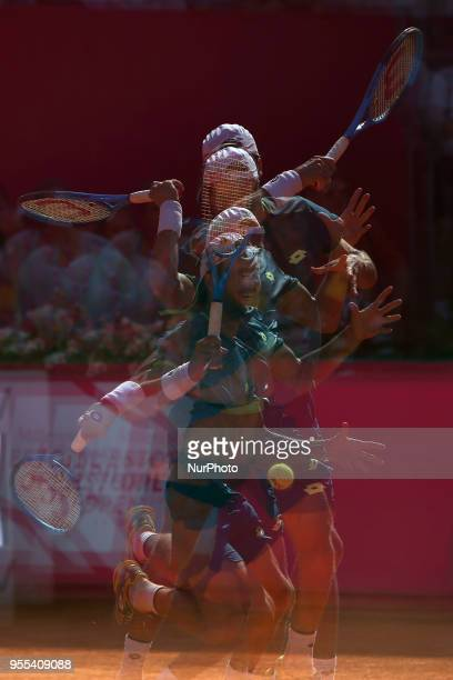 Joao Sousa of Portugal returns a ball to Frances Tiafoe of US during the Millennium Estoril Open ATP 250 tennis tournament final at the Clube de...