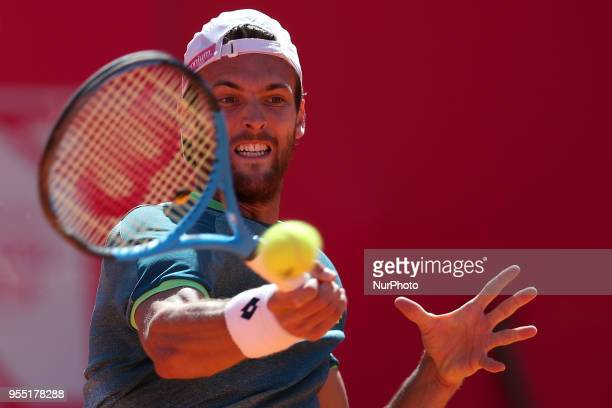 Joao Sousa of Portugal returns a ball to Stefanos Tsitsipas of Greece during the Millennium Estoril Open ATP 250 tennis tournament semifinal at the...