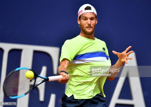 Joao Sousa of Portugal returns the ball to Germany's Philipp Kohlschreiber during their final match at the ATP tennis tournament Generali Open on...