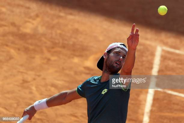 Joao Sousa of Portugal serves a ball to Frances Tiafoe of US during the Millennium Estoril Open ATP 250 tennis tournament final at the Clube de Tenis...