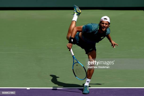 Joao Sousa of Portugal serves against Hyeon Chung of Korea during the Miami Open Presented by Itau at Crandon Park Tennis Center on March 27 2018 in...