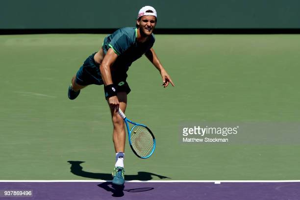 Joao Sousa of Portugal serves to Jared Donaldson during the Miami Open Presented by Itau at Crandon Park Tennis Center on March 25 2018 in Key...