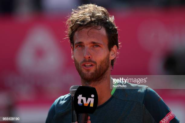 Joao Sousa of Portugal speaks to the press after winning the Millennium Estoril Open ATP 250 tennis tournament final against Frances Tiafoe of US at...