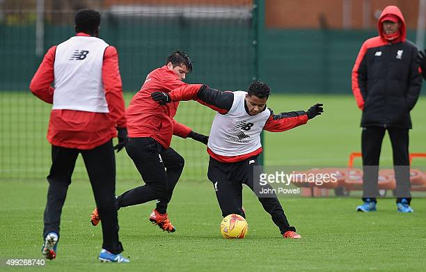 Joao Teixeira and Allan Rodrigues de Souza of Liverpool during a training session at Melwood Training Ground on November 30 2015 in Liverpool England