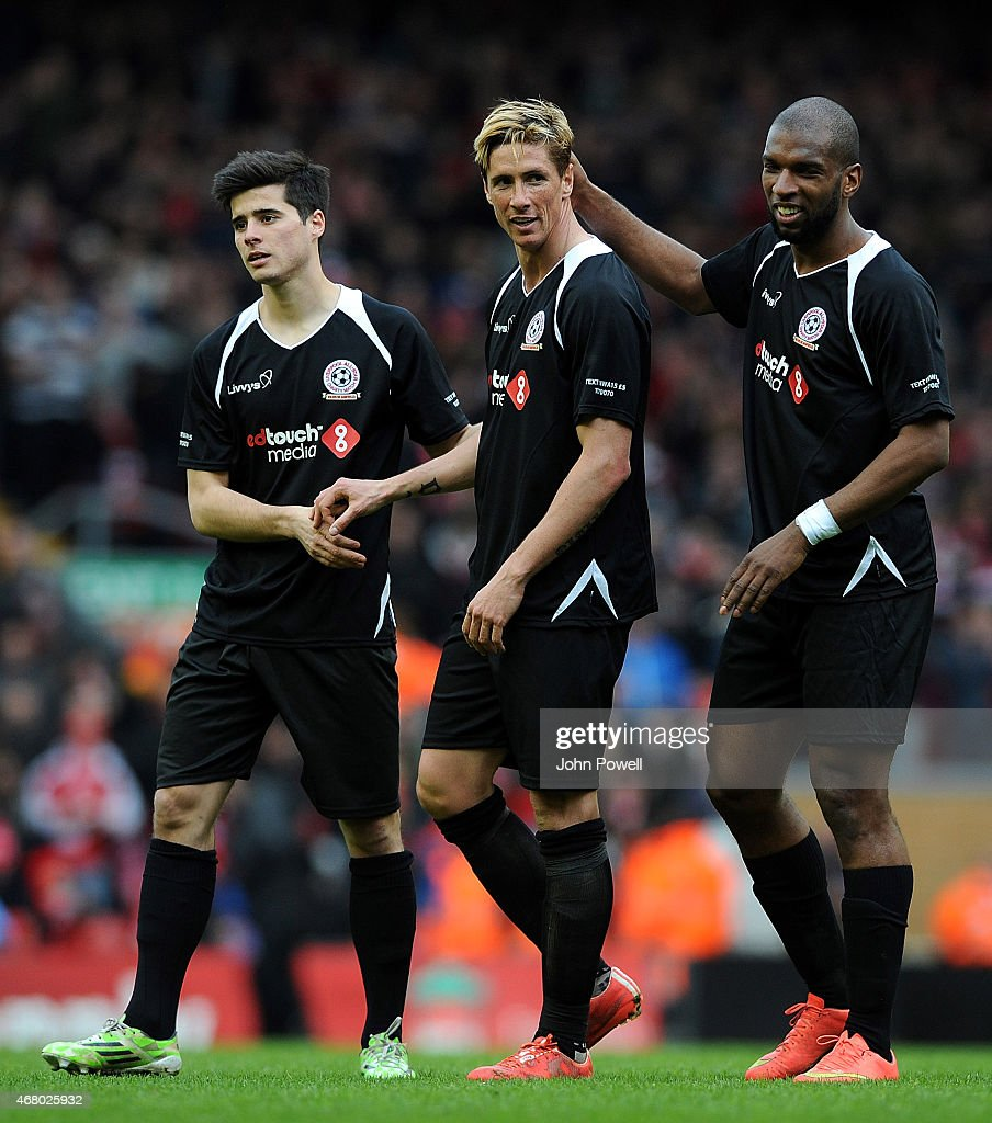 Joao Teixeira, Fernando Torres and Ryan Babel walk around the pitch at the end of the Liverpool All Star Charity Match at Anfield on March 29, 2015 in Liverpool, England.