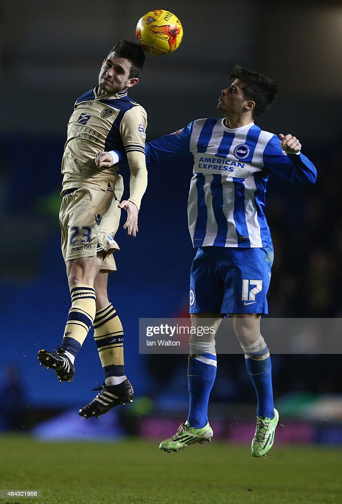 Joao Teixeira of Brighton & Hove Albion tries to tackle Lewis Cook of Leeds during the Sky Bet Championship match between Brighton & Hove Albion and Leeds United at Amex Stadium on February 24, 2015 in Brighton, England.