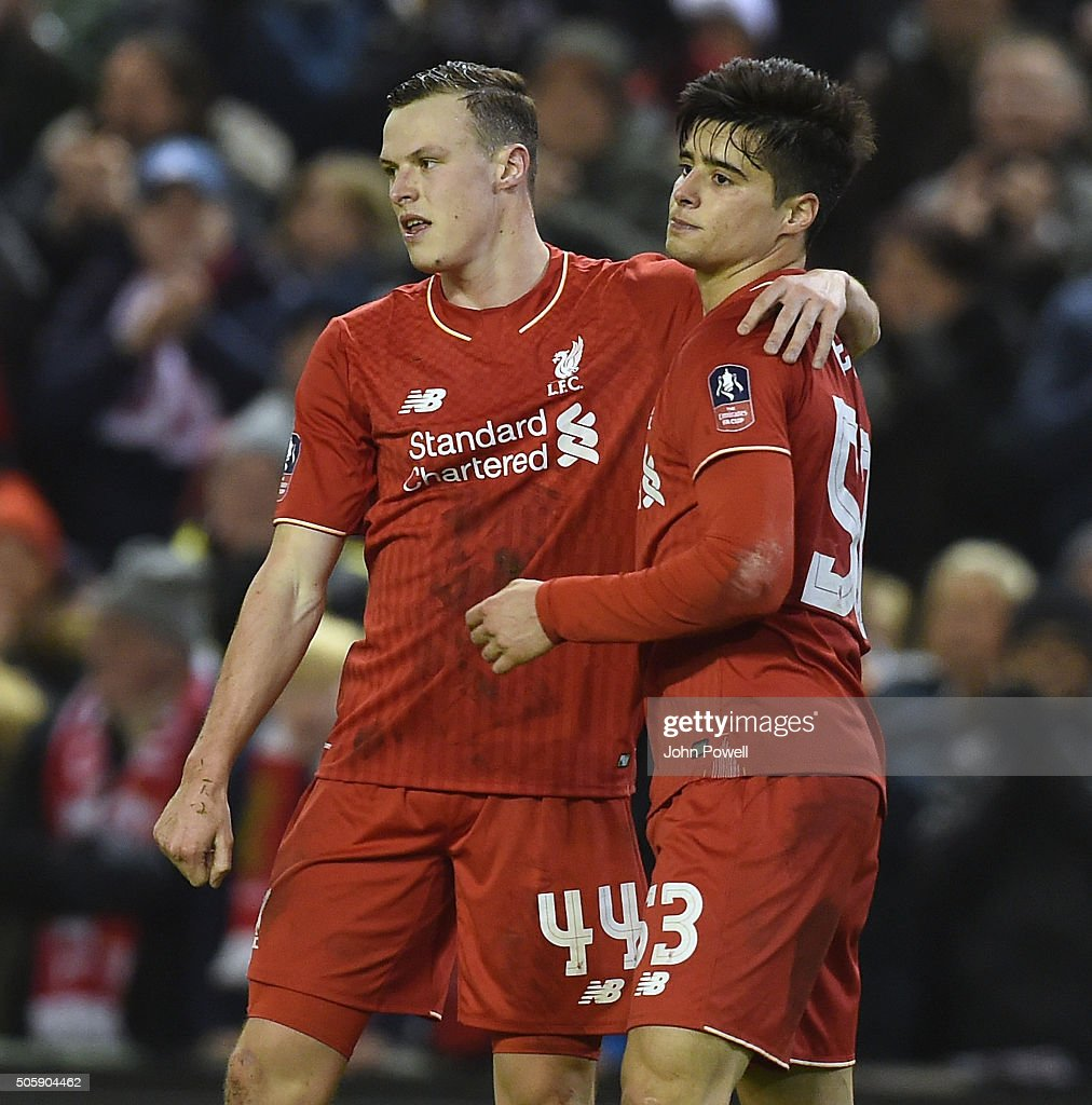 Joao Teixeira of Liverpool celebrates his goal with Brad Smith of Liverpool during The Emirates FA Cup Third Round Replay between Liverpool and Exeter City at Anfield on January 20, 2016 in Liverpool, England.