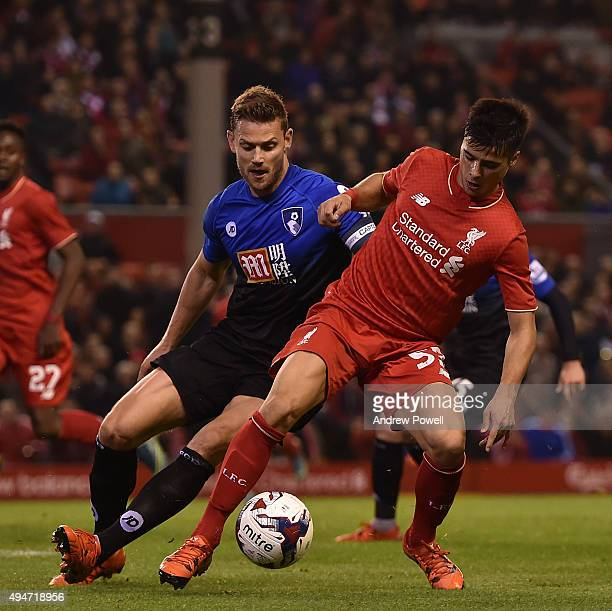 Joao Teixeira of Liverpool competes with Simon Francis of AFC Bournemouth during the Capital One Cup Fourth Round match between Liverpool and AFC...