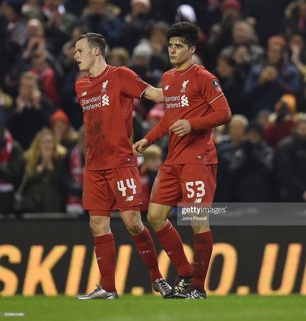 Joao Teixeira of Liverpool is congratulated after his goal during The Emirates FA Cup Third Round Replay between Liverpool and Exeter City at Anfield on January 20, 2016 in Liverpool, England.