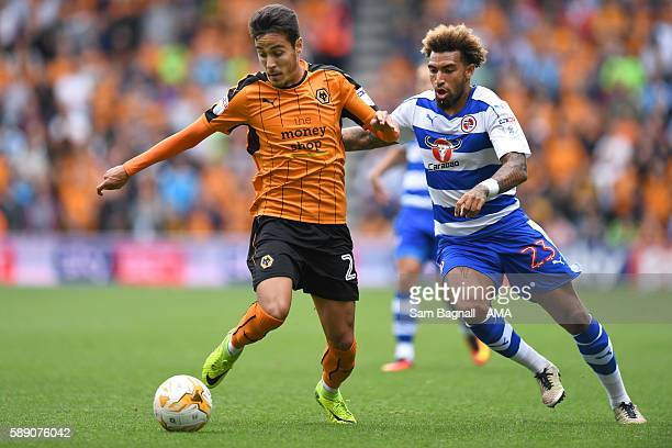 Joao Teixeira of Wolverhampton Wanderers and Danny Williams of Reading during the Sky Bet Championship match between Wolverhampton Wanderers and...
