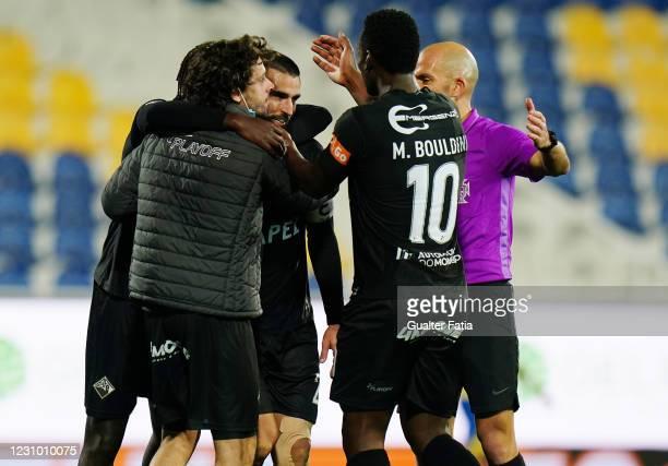 Joao Traquina of Academica De Coimbra celebrates with teammates after scoring a goal during the Liga 2 Sabseg match between GD Estoril Praia and...