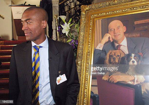 Joao Varela the number two candidate of the rightwing LPF political party stands next to a portrait of the late Pim Fortuyn in The Hague May 15 after...