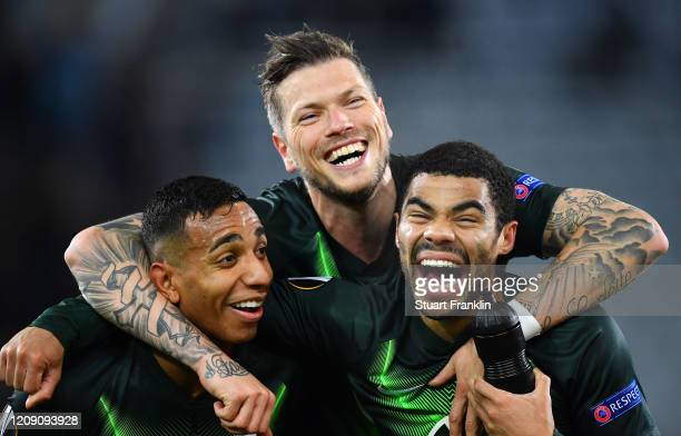 Joao Victor Daniel Ginczek and Paulo Otavio of VfL Wolfsburg celebrate after the UEFA Europa League round of 32 second leg match between Malmo FF and...