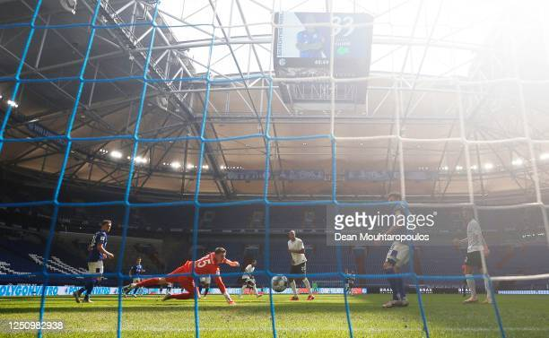Joao Victor of VfL Wolfsburg scores a goal past Alexander Nuebel FC Schalke 04during the Bundesliga match between FC Schalke 04 and VfL Wolfsburg at...