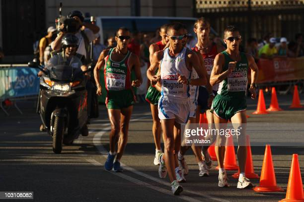 Joao Vieira of Portugal, Ivano Brugnetti of Italy and Robert Heffernan of Ireland compete in the Mens 20km Walk Final during day one of the 20th...